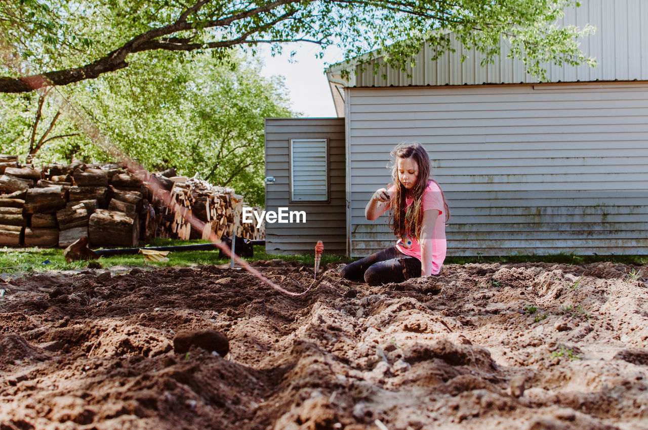Full Length Of Woman Digging Mud