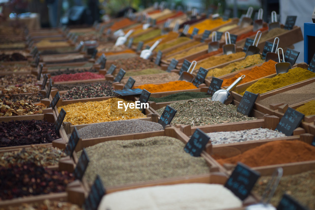 selective focus, in a row, abundance, food and drink, large group of objects, choice, variation, food, for sale, no people, arrangement, retail, side by side, spice, business, market, order, freshness, market stall, indoors, retail display