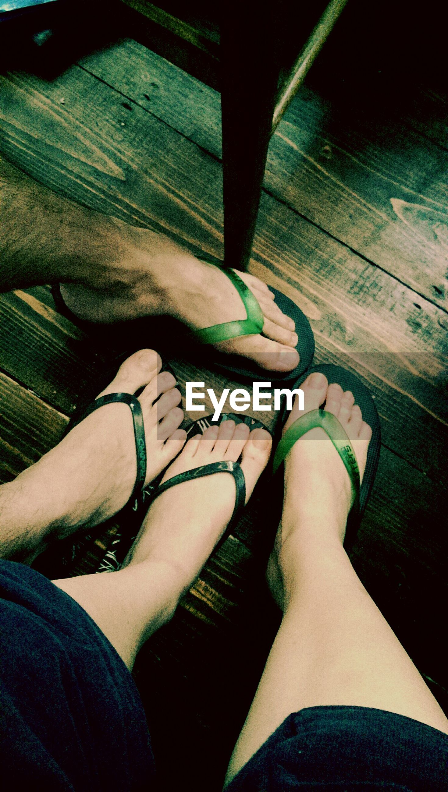 low section, person, personal perspective, lifestyles, human foot, shoe, high angle view, leisure activity, indoors, barefoot, standing, relaxation, part of, sitting, legs crossed at ankle, footwear