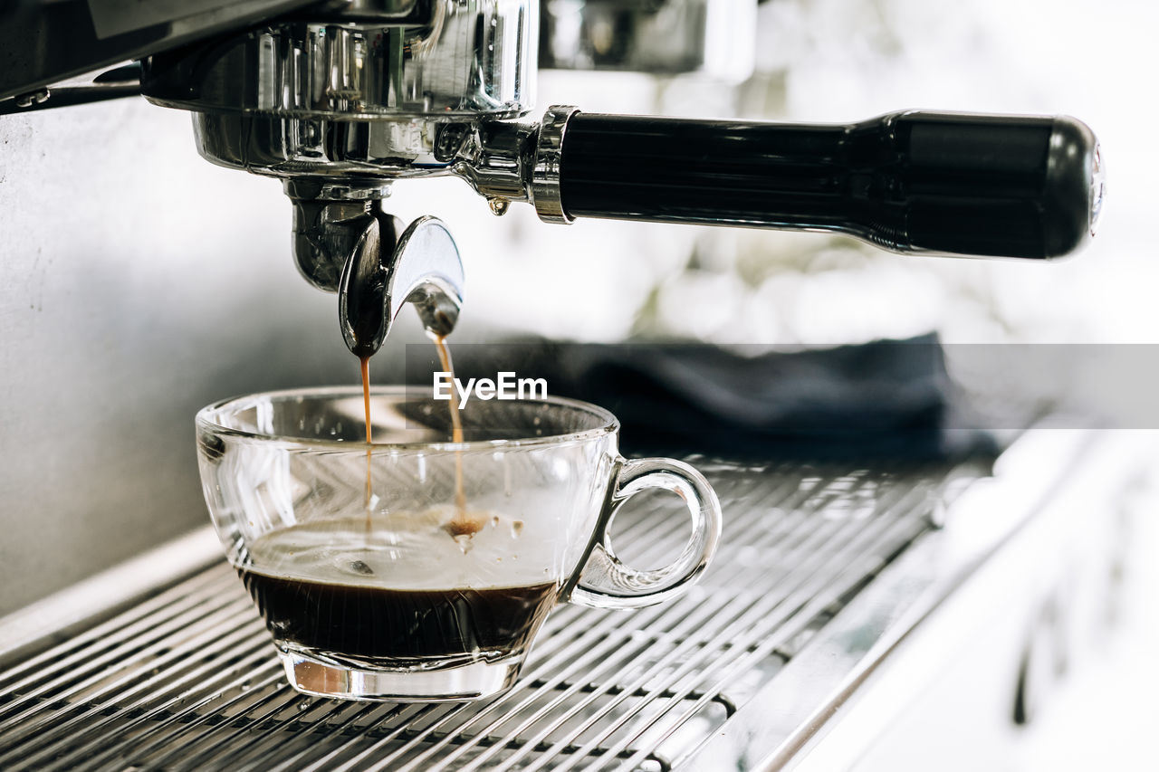 food and drink, drink, coffee - drink, coffee, cup, refreshment, coffee cup, coffee maker, mug, appliance, machinery, pouring, cafe, espresso maker, close-up, indoors, freshness, espresso, motion, preparation, no people, coffee shop, crockery, caffeine
