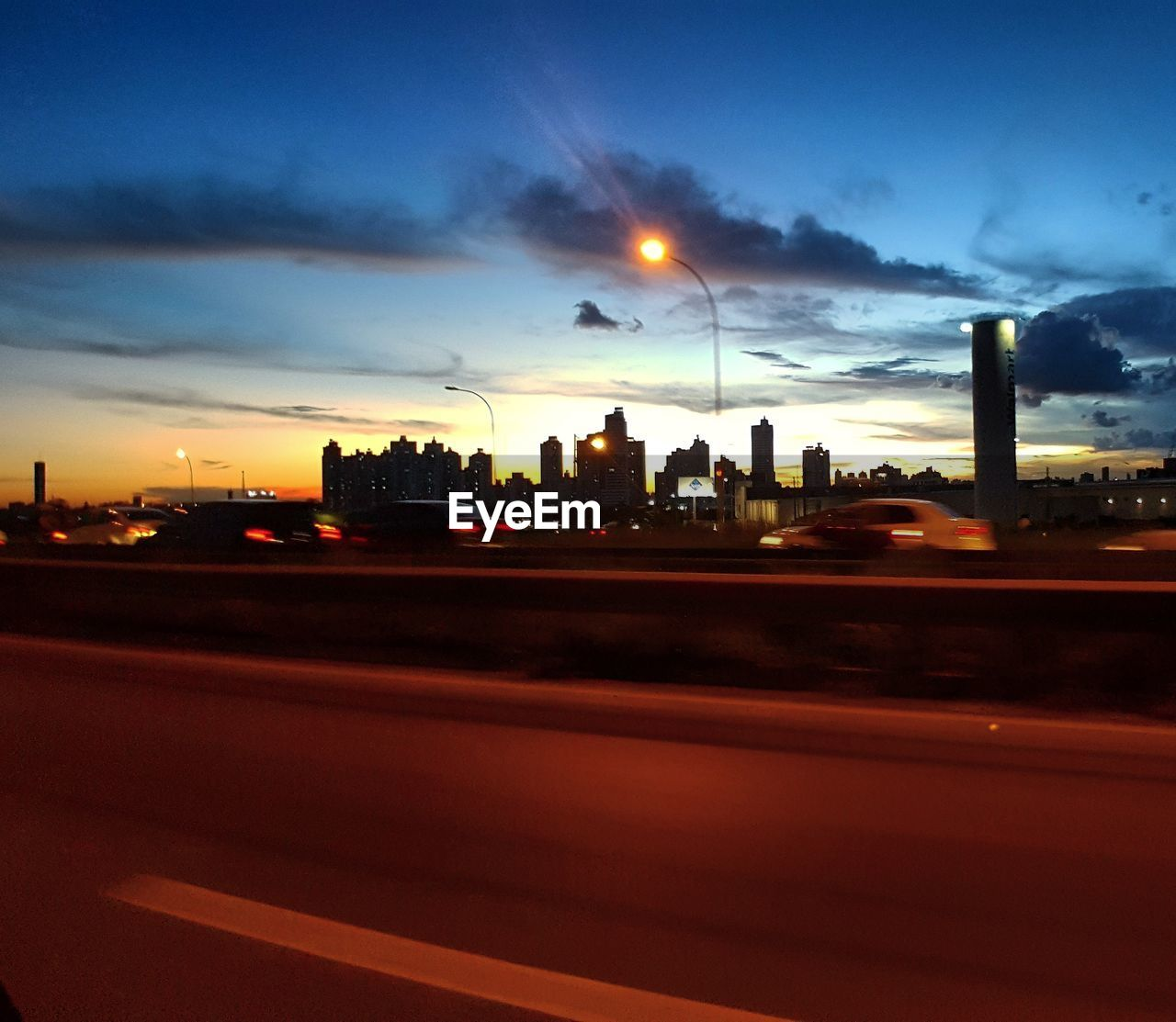 sky, illuminated, cloud - sky, built structure, sunset, architecture, no people, building exterior, road, city, night, travel destinations, cityscape, outdoors, skyscraper, nature