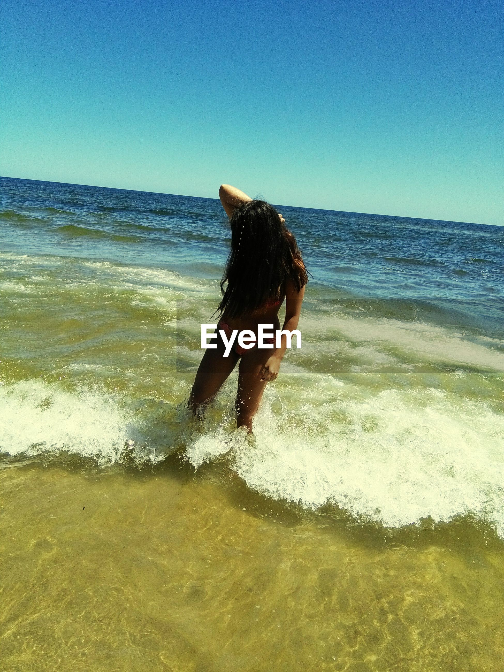 sea, beach, water, horizon over water, sand, shore, clear sky, sky, nature, day, real people, sunlight, wave, outdoors, beauty in nature, scenics, one person, mammal, animal themes, people
