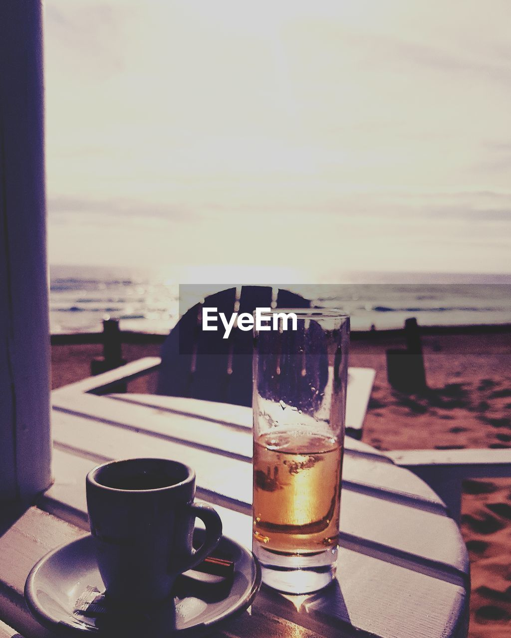 drink, sea, refreshment, table, food and drink, water, horizon over water, beach, drinking glass, no people, sky, alcohol, outdoors, freshness, scenics, day, close-up, nature