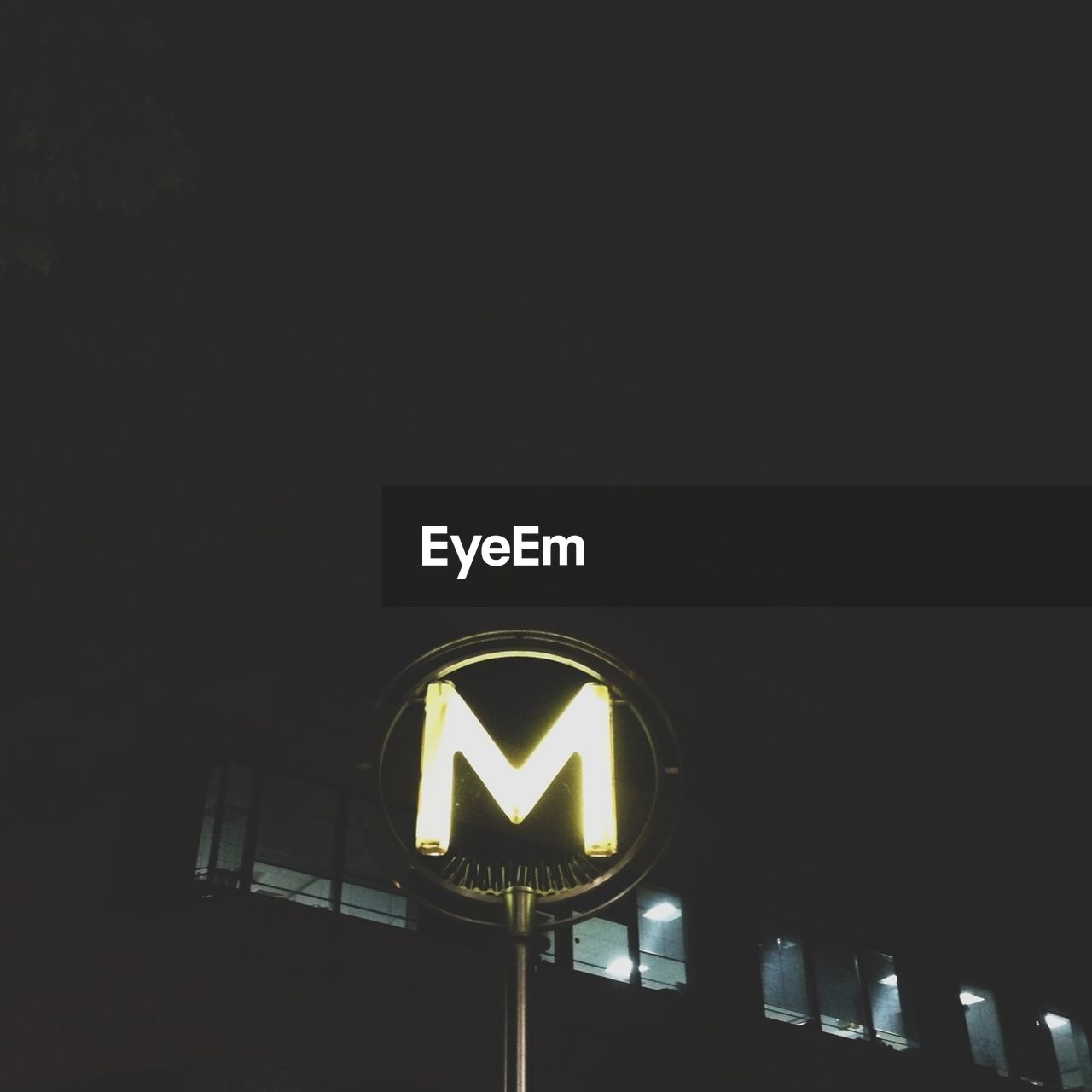 Illuminated sign with letter m