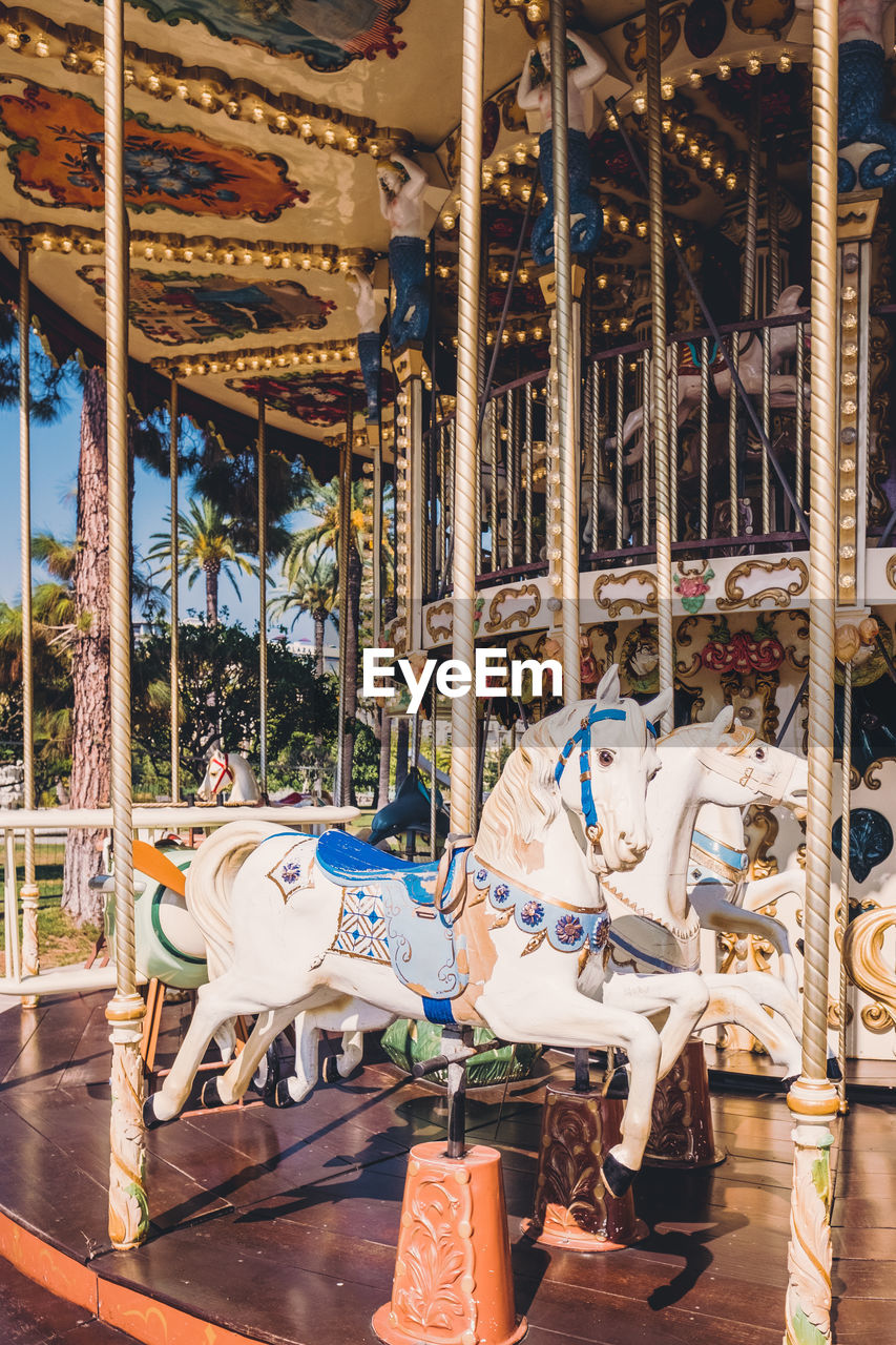 carousel, amusement park, amusement park ride, carousel horses, animal representation, representation, domestic, domestic animals, mammal, animal, arts culture and entertainment, horse, animal wildlife, livestock, day, enjoyment, outdoors, leisure activity, architecture, no people, merry-go-round