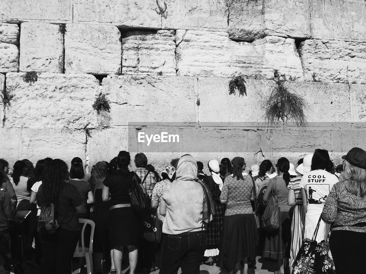 PEOPLE STANDING AGAINST WALL