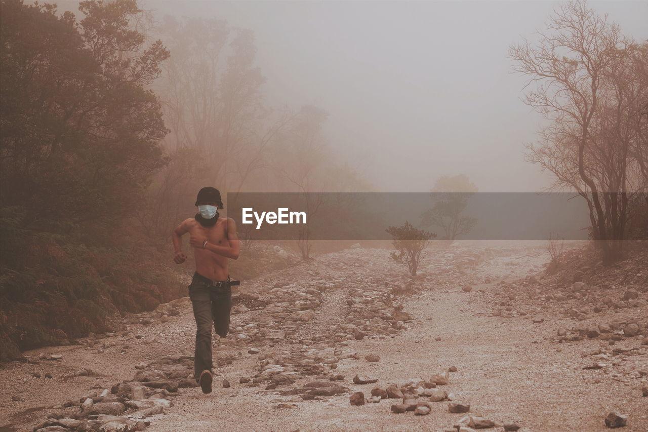 A man runs in the morning mist