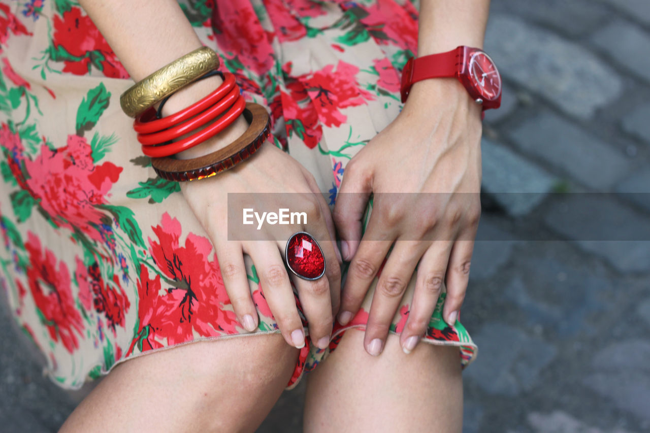 Midsection Of Woman Wearing Ring And Bangles