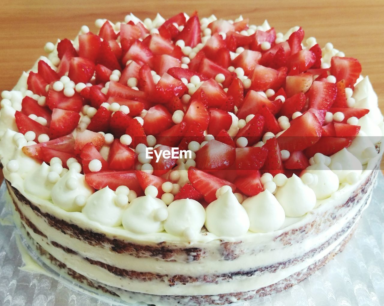 Close-Up Of Strawberry Cake Served On Table