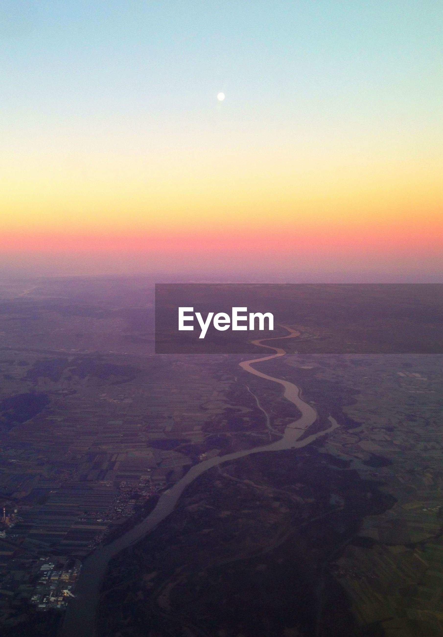 sunset, scenics, landscape, tranquil scene, beauty in nature, tranquility, aerial view, orange color, nature, sky, sun, idyllic, horizon over land, copy space, high angle view, outdoors, clear sky, sunlight, no people, remote