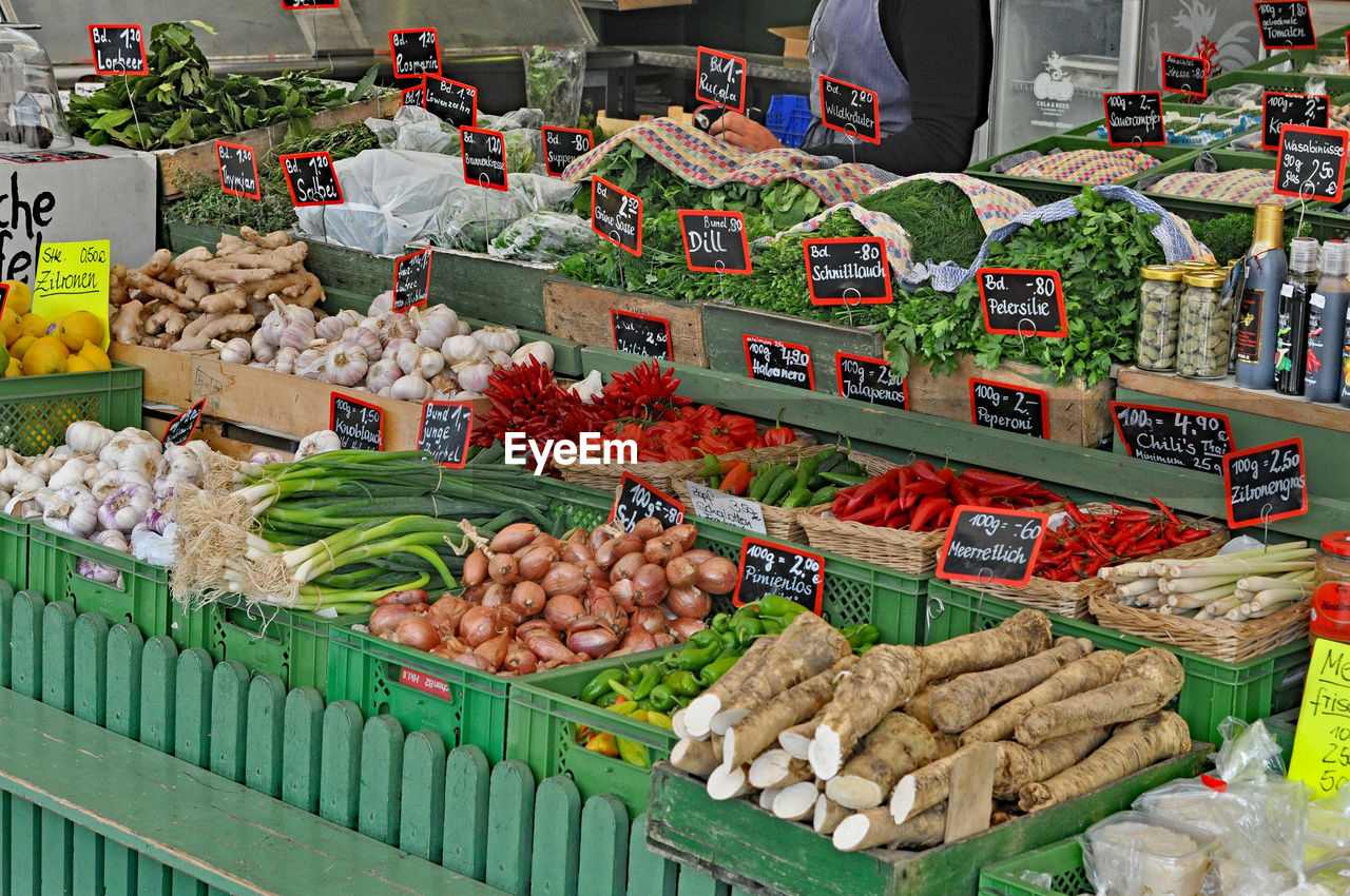 Vegetables In Crates At Market For Sale