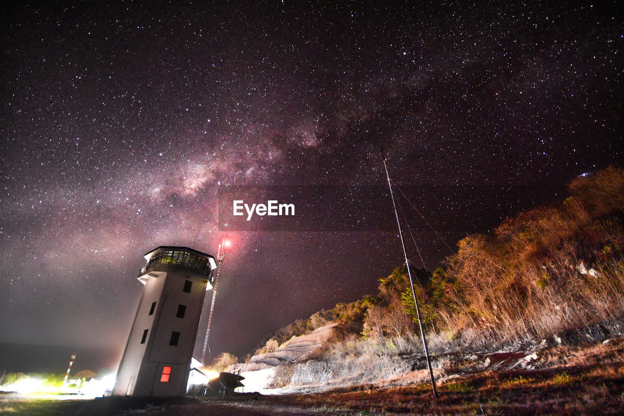 star - space, night, tower, astronomy, space, sky, building exterior, guidance, lighthouse, galaxy, built structure, architecture, nature, no people, low angle view, illuminated, building, beauty in nature, outdoors, land, milky way
