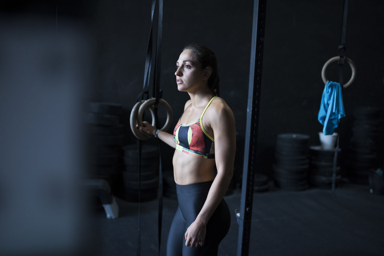 Young Woman Standing At Gym
