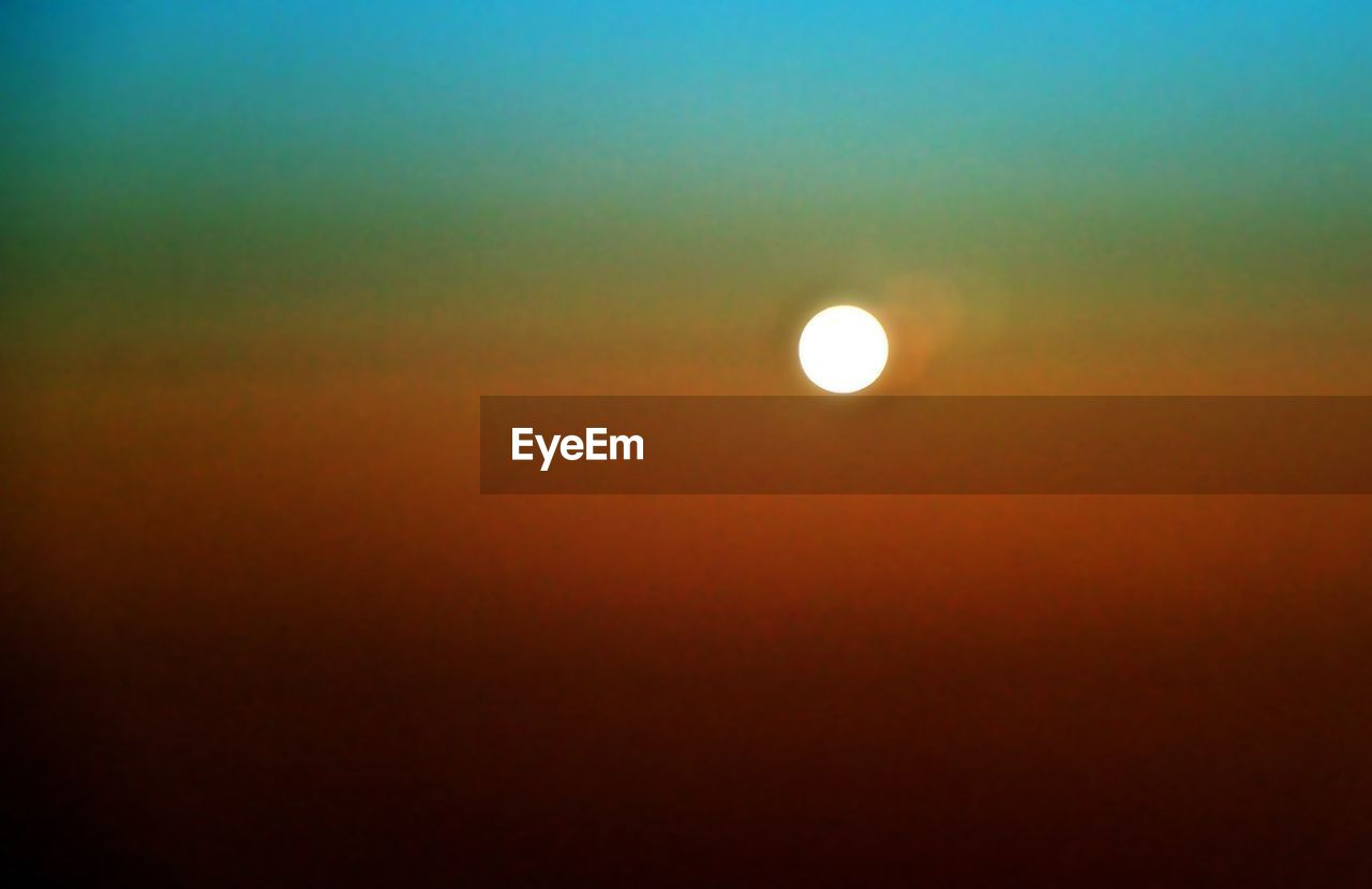 moon, beauty in nature, scenics, nature, tranquil scene, night, astronomy, tranquility, orange color, sky, idyllic, crescent, no people, outdoors, natural phenomenon, half moon, sunset, sky only, space, solar eclipse, clear sky