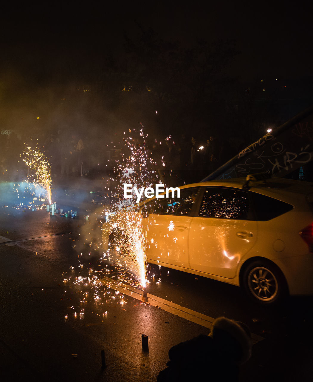 night, car, illuminated, mode of transportation, motor vehicle, transportation, motion, land vehicle, long exposure, blurred motion, sparks, city, event, celebration, architecture, firework, street, nature, arts culture and entertainment, firework - man made object, firework display