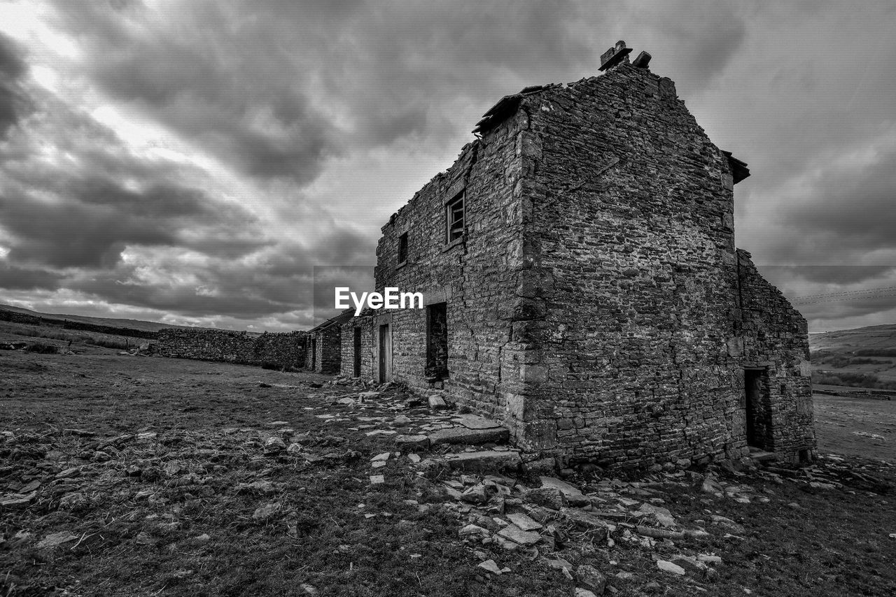 architecture, built structure, sky, history, cloud - sky, the past, abandoned, old, nature, old ruin, building exterior, damaged, day, no people, building, ancient, land, deterioration, decline, outdoors, ruined, stone wall