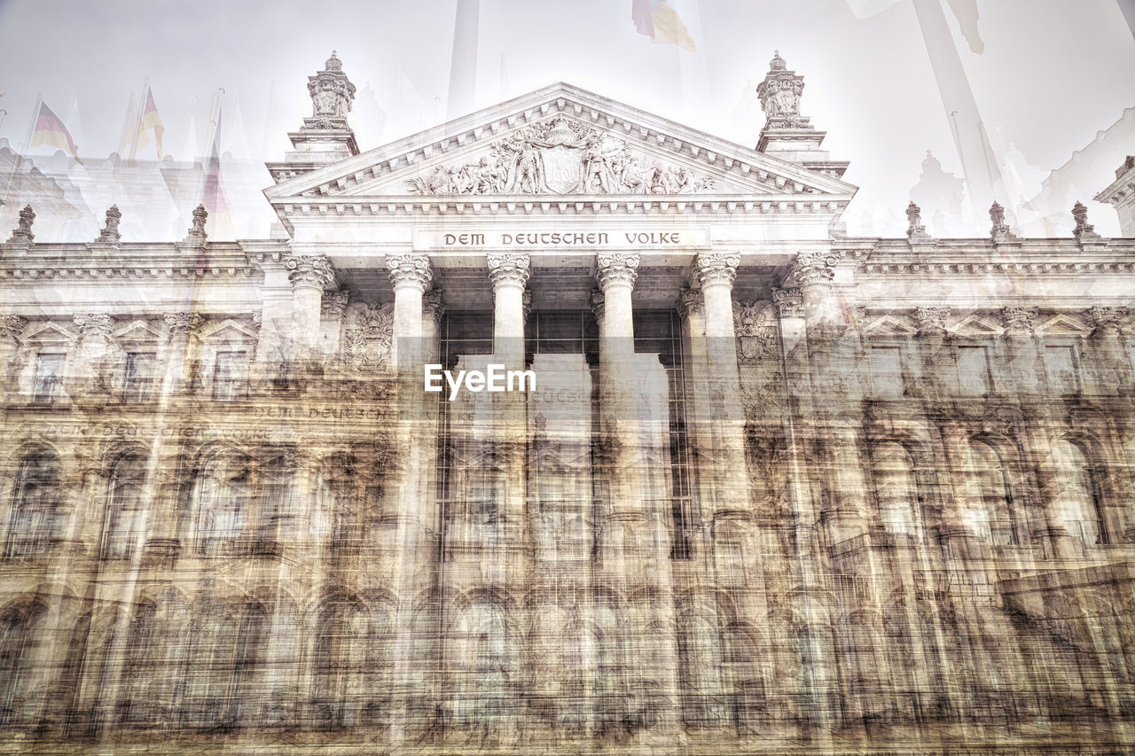 Low Angle Double Exposure Exterior View Of The Reichstag Building In Berlin