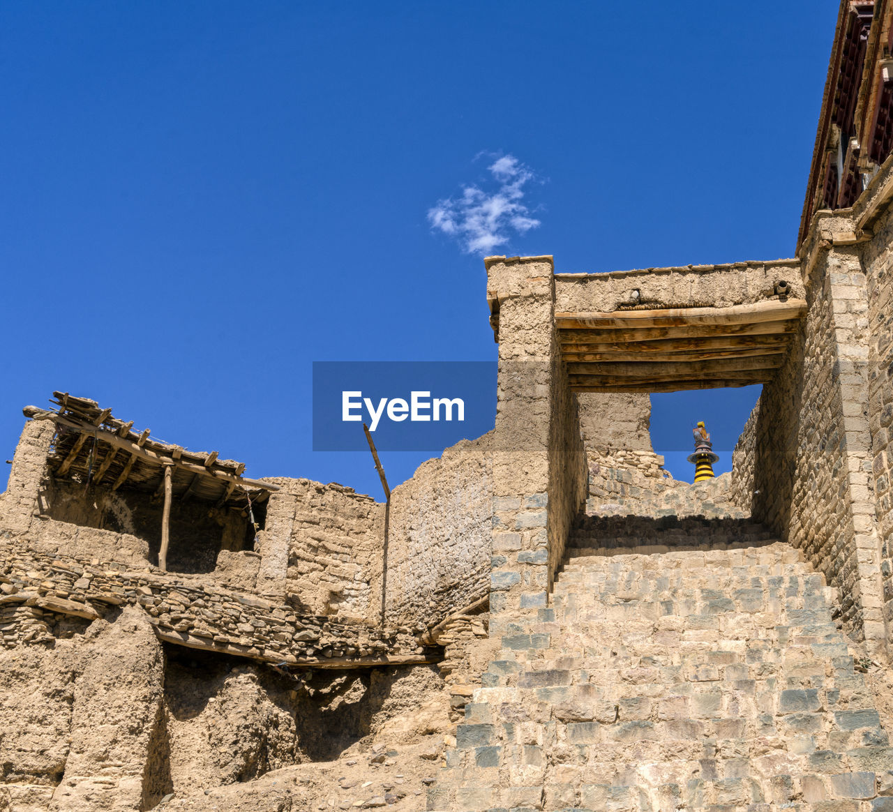 architecture, built structure, history, the past, sky, old ruin, ancient, low angle view, building exterior, blue, day, nature, no people, ancient civilization, damaged, travel destinations, sunlight, old, tourism, building, ruined, outdoors, archaeology, stone wall