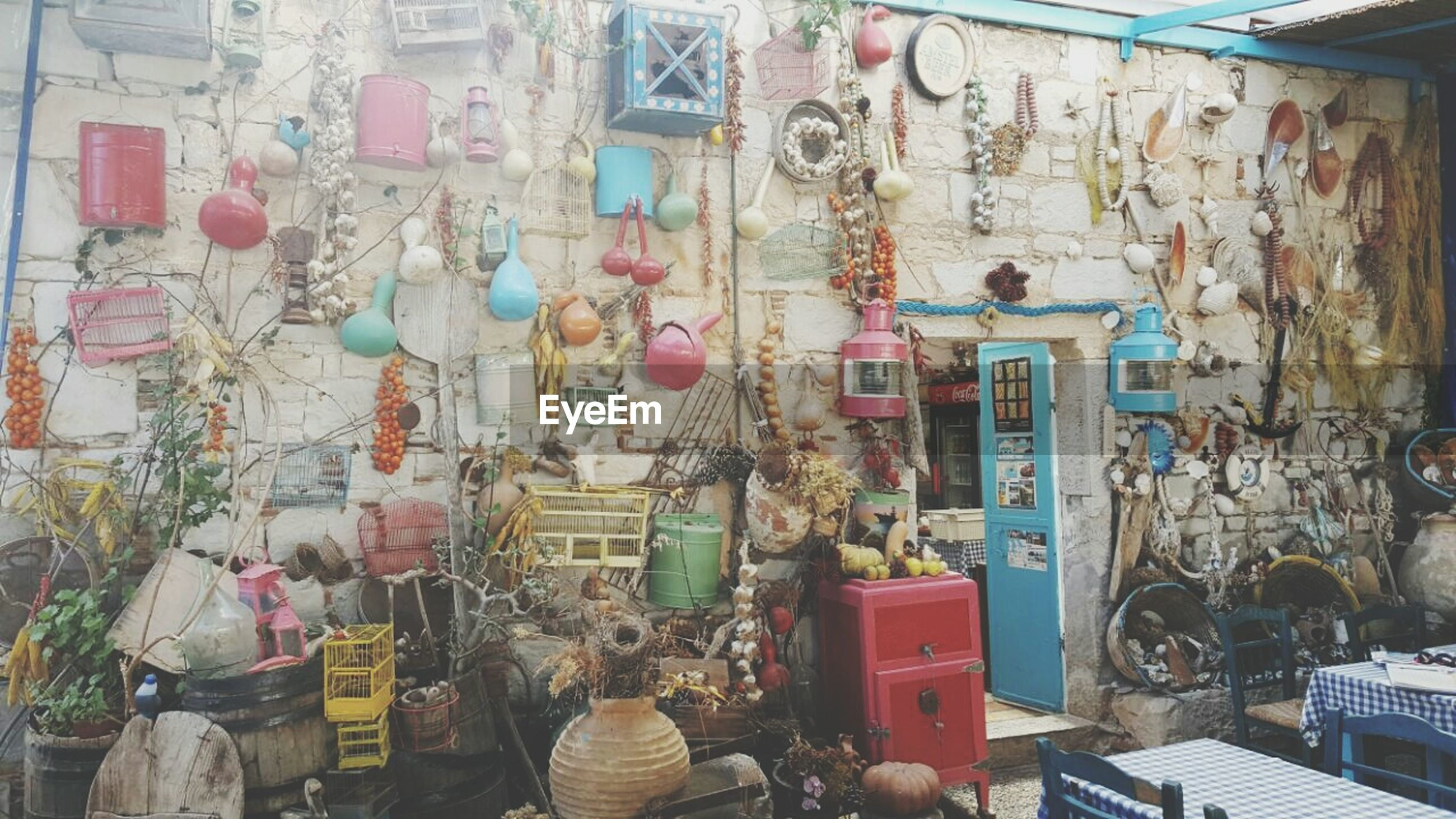 architecture, built structure, building exterior, retail, store, market, for sale, wall - building feature, hanging, variation, multi colored, market stall, art and craft, graffiti, large group of objects, art, day, choice, outdoors, no people