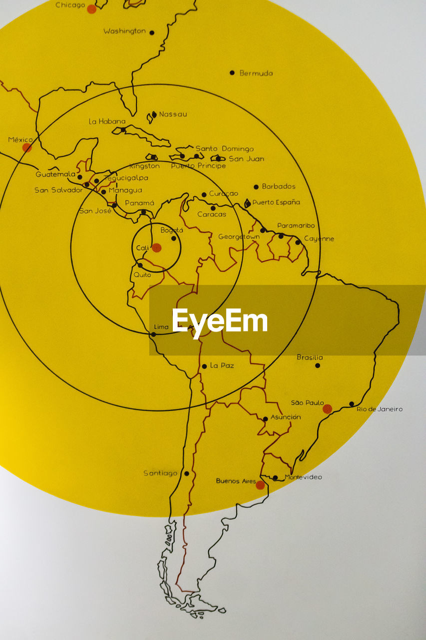 map, no people, close-up, indoors, nature, studio shot, yellow, text, paper, physical geography, communication, direction, western script, sphere, art and craft, world map, representation, shape