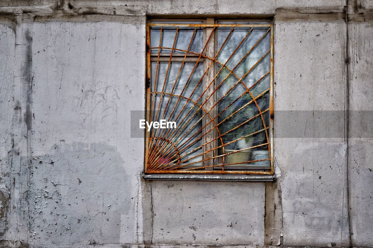 architecture, built structure, no people, day, building exterior, wood - material, wall - building feature, window, building, outdoors, pattern, house, design, old, metal, damaged, broken, abandoned, low angle view, close-up