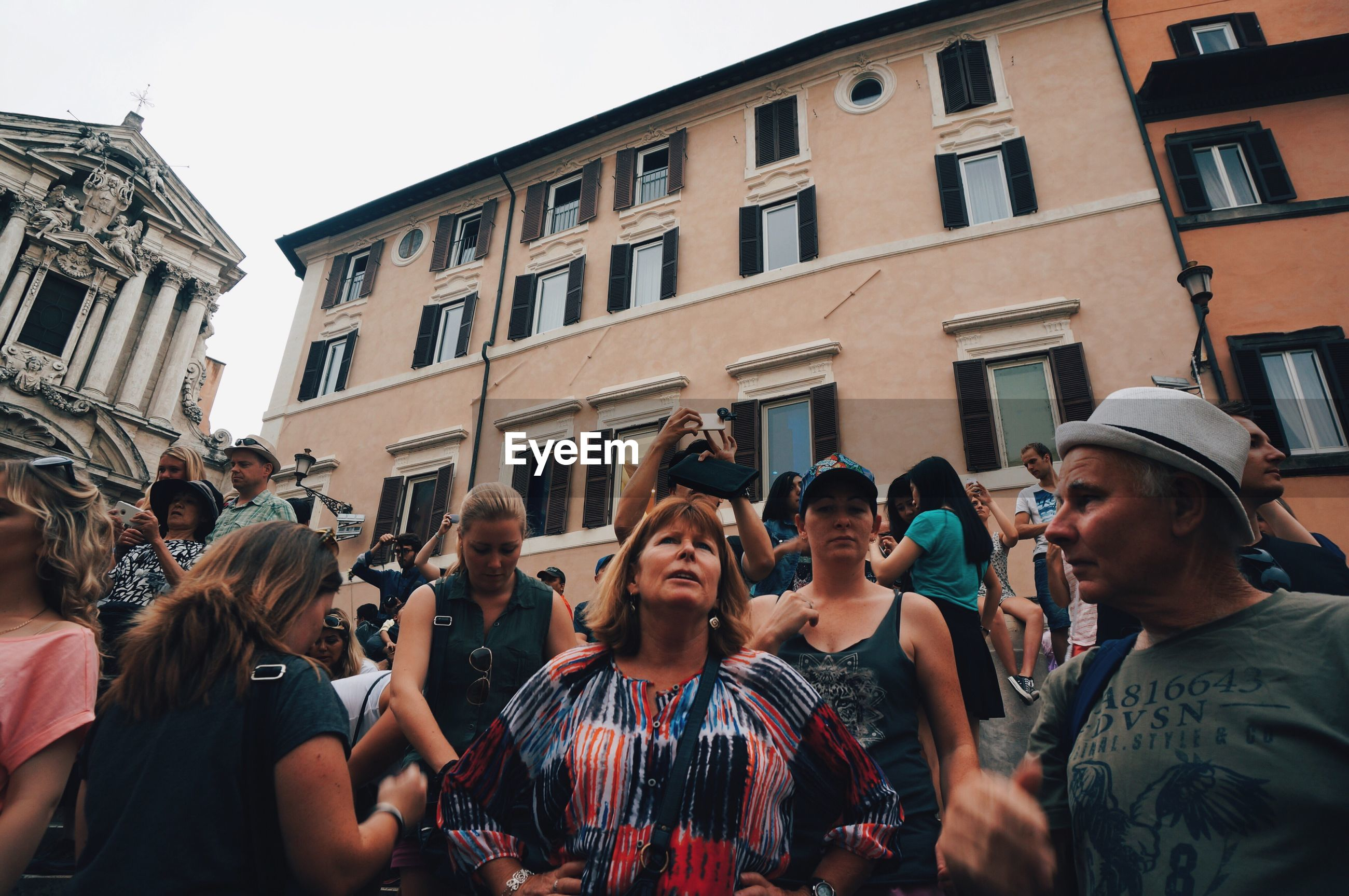 large group of people, person, togetherness, building exterior, leisure activity, celebration, men, street, lifestyles, city, casual clothing, arts culture and entertainment, architecture, event, crowd, sky, holding, enjoyment, teamwork, outdoors