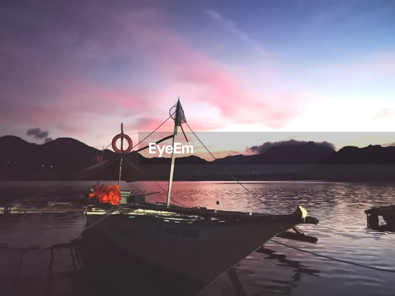 water, sky, sunset, beauty in nature, scenics - nature, cloud - sky, nautical vessel, tranquility, transportation, tranquil scene, nature, reflection, mode of transportation, no people, mountain, lake, silhouette, outdoors, bay, sailboat