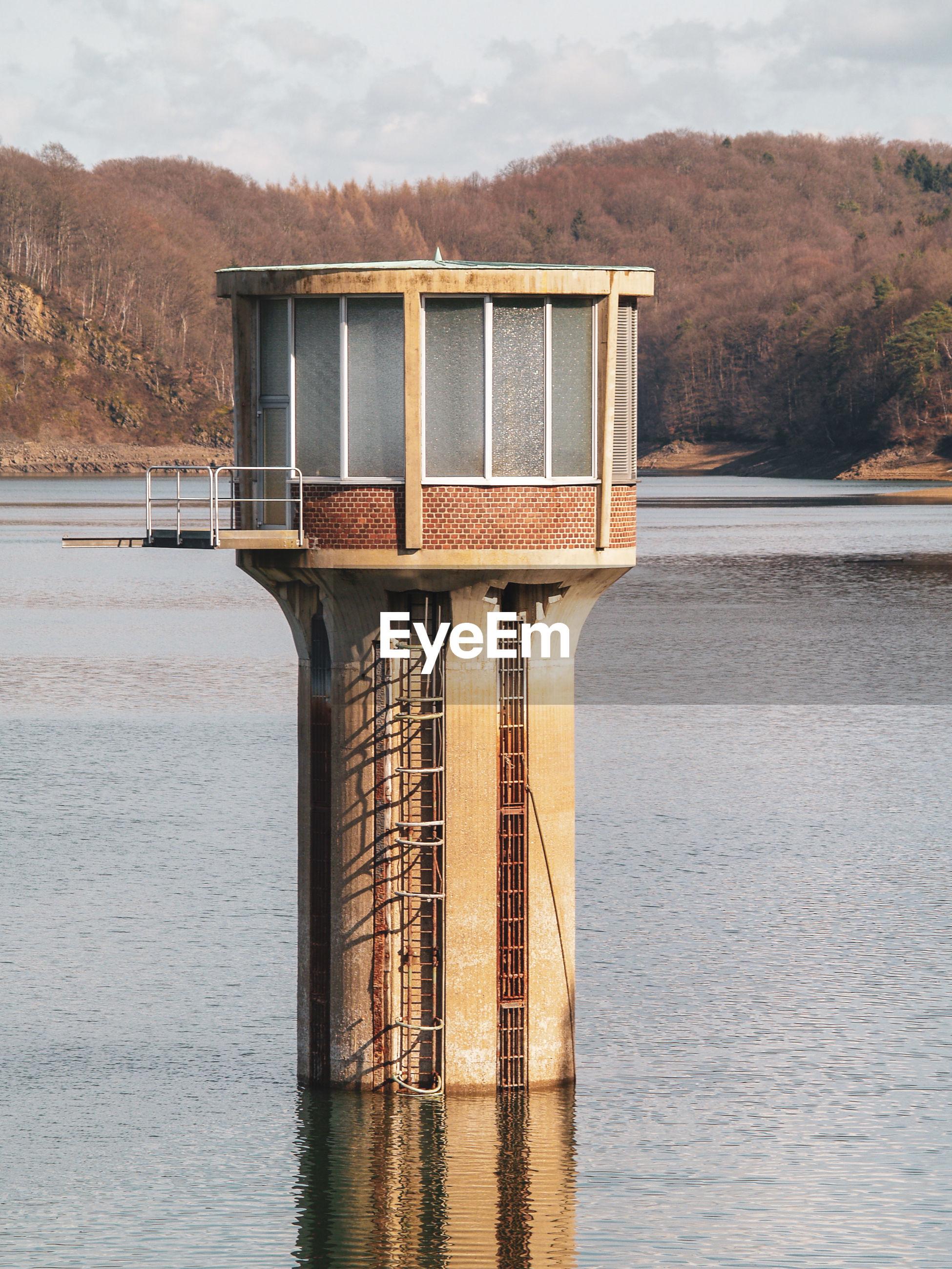 BUILT STRUCTURE AGAINST LAKE