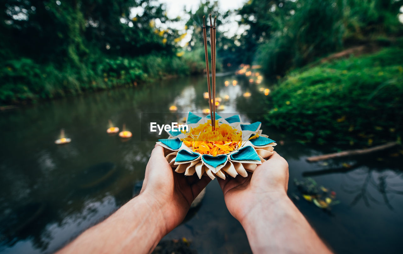human hand, hand, human body part, holding, nature, plant, one person, focus on foreground, real people, freshness, day, lifestyles, body part, water, outdoors, personal perspective, unrecognizable person, flowering plant, finger
