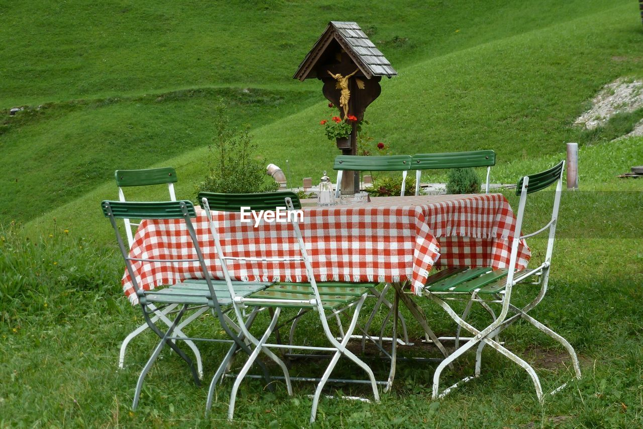 Chairs and table on grassy field