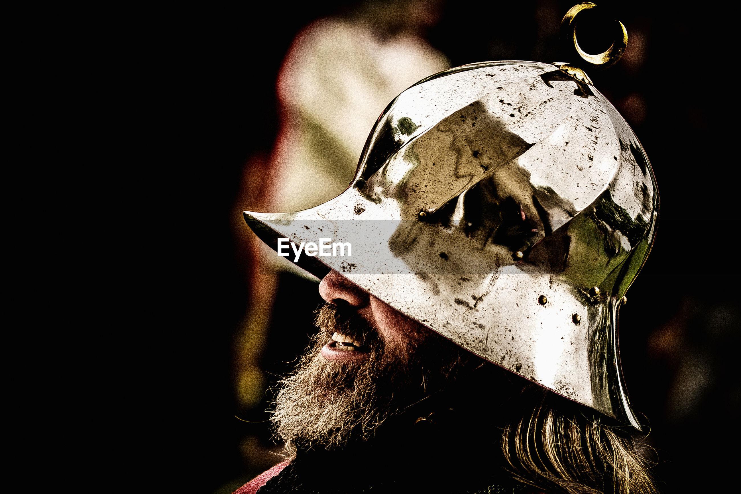 Close-up of bearded man wearing warrior helmet