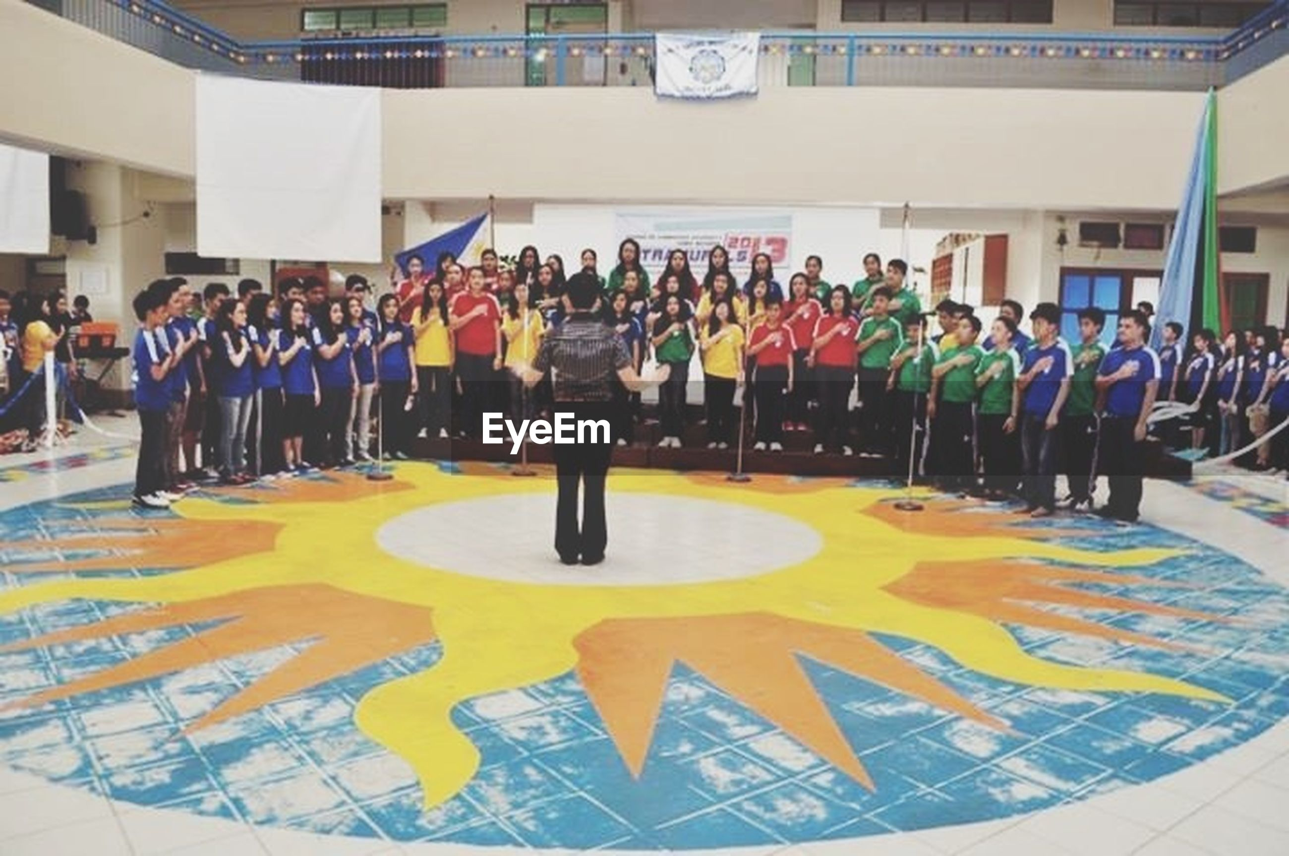 multi colored, creativity, art, art and craft, person, men, large group of people, lifestyles, indoors, leisure activity, in a row, variation, built structure, arrangement, human representation, standing, architecture, flooring, incidental people