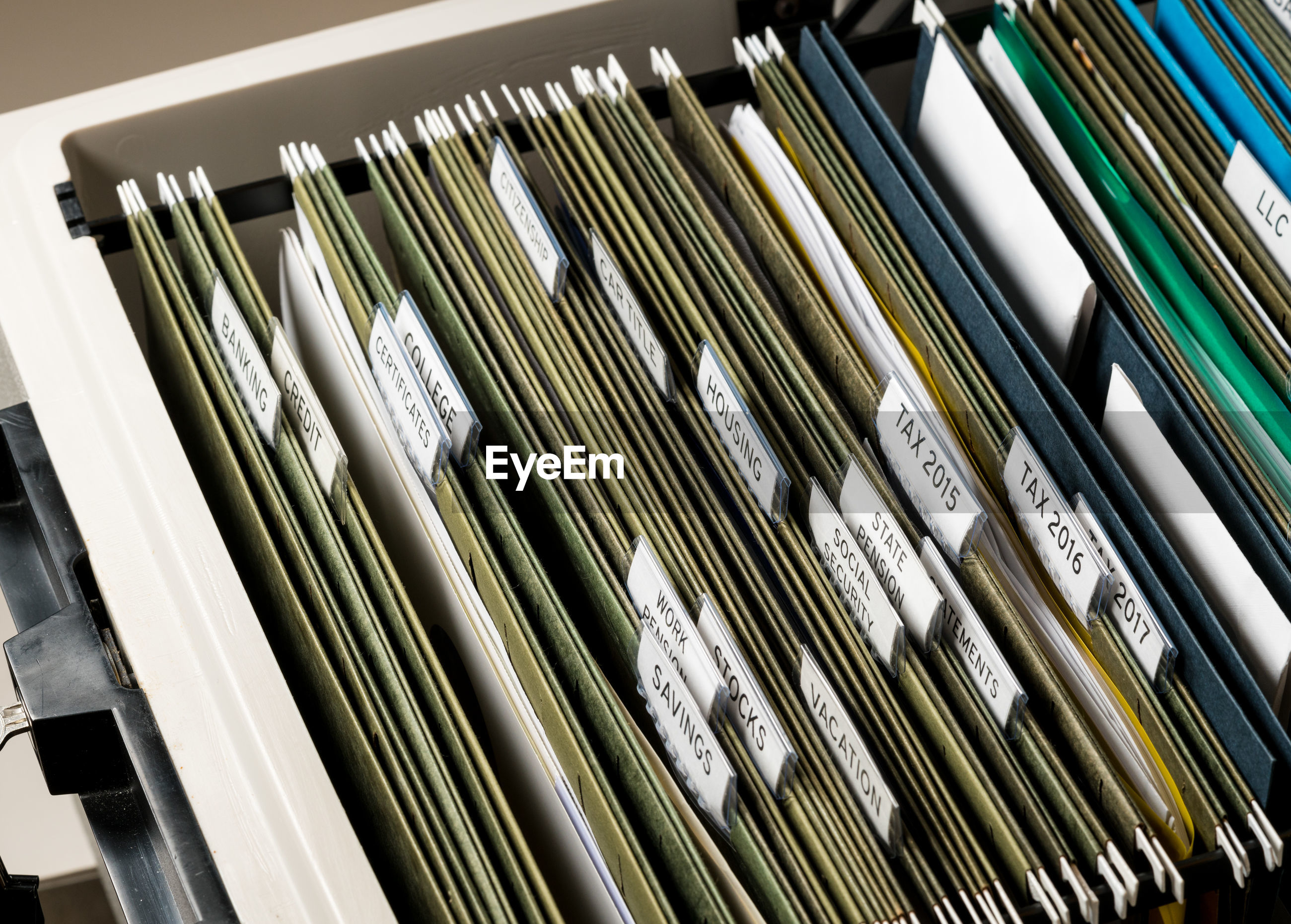 High angle view of documents arranged in drawer