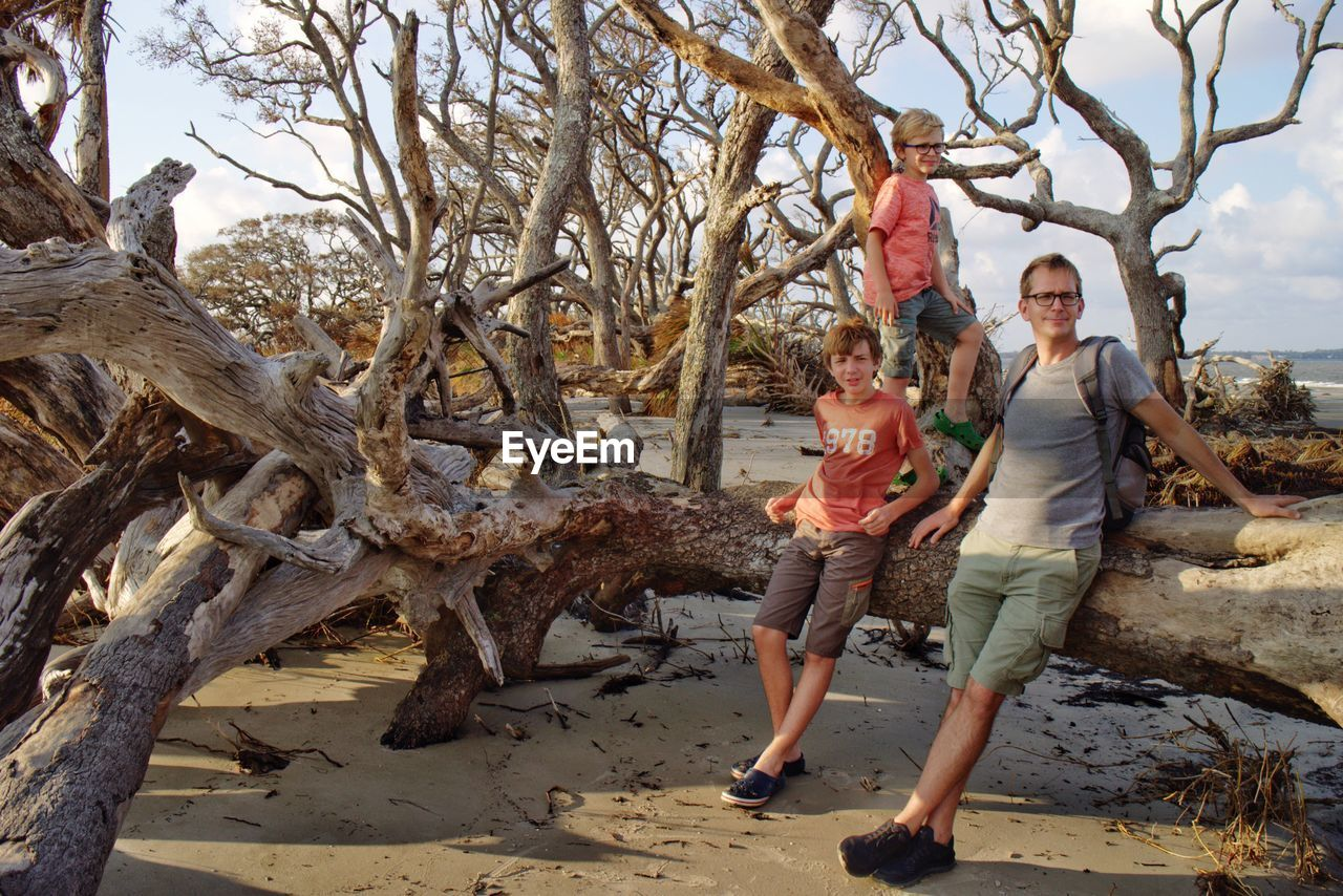 Full length of father with sons at beach