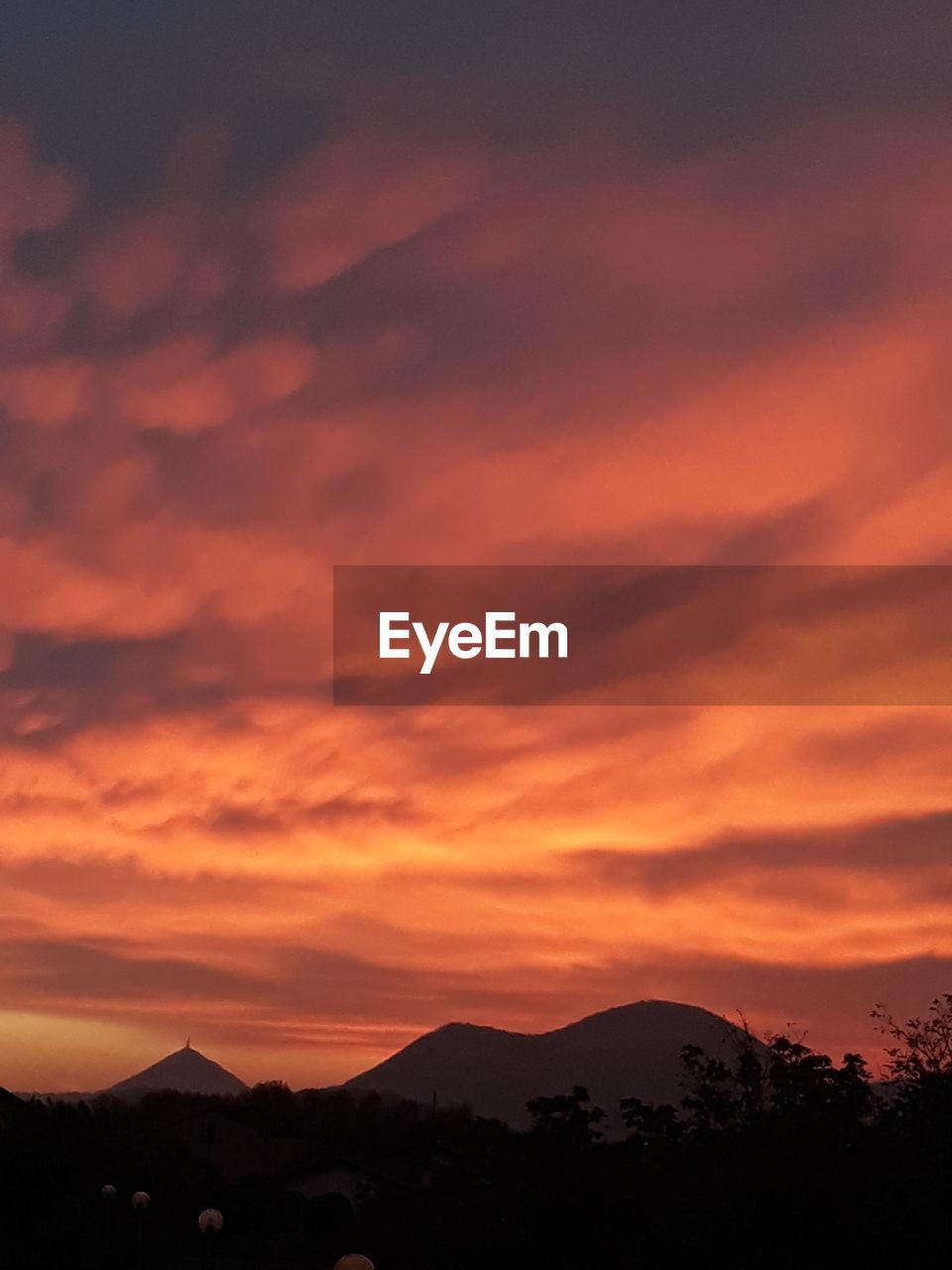 sky, sunset, scenics - nature, beauty in nature, mountain, silhouette, cloud - sky, orange color, tranquil scene, tranquility, idyllic, environment, mountain range, no people, non-urban scene, nature, landscape, dramatic sky, outdoors, remote, mountain peak, romantic sky