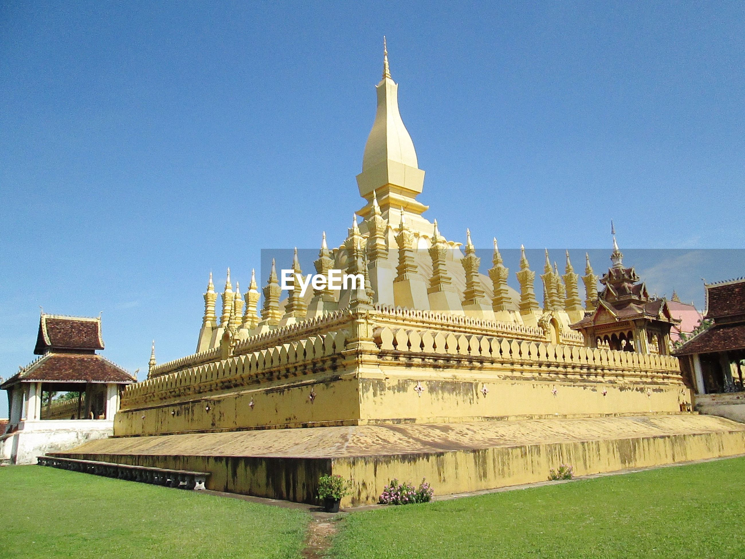 Pha that luang against clear blue sky