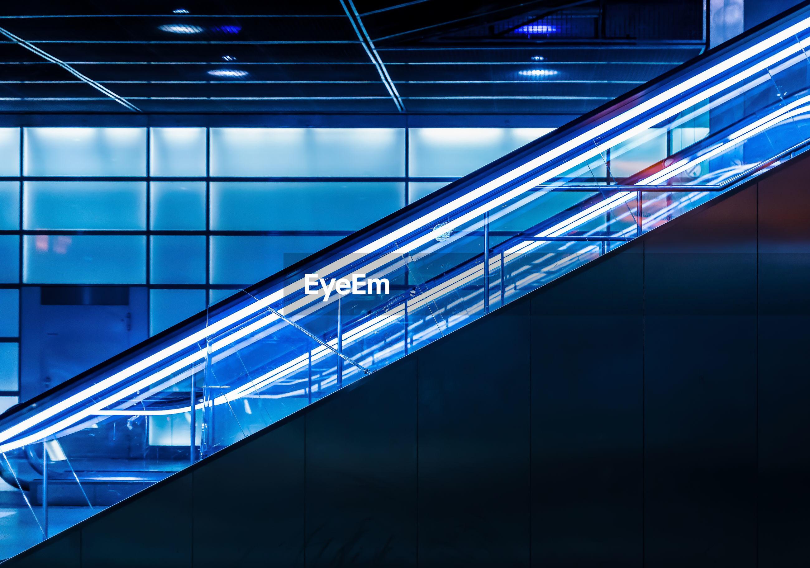 Illuminated escalator at subway station