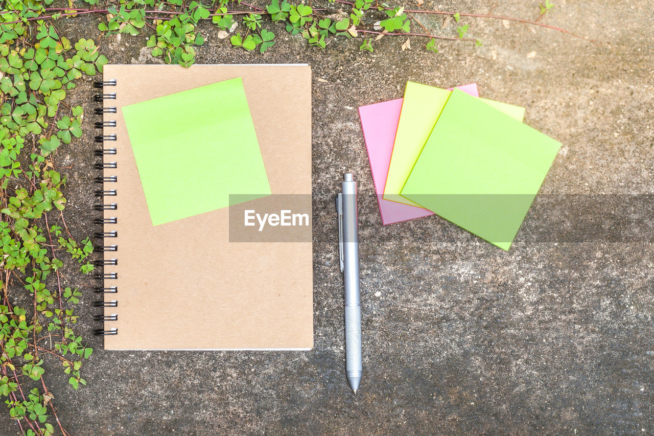 note, reminder, paper, adhesive note, high angle view, no people, close-up, blank, communication, message, day, directly above, yellow, planning, multi colored, pink color, writing, outdoors, plant, green color