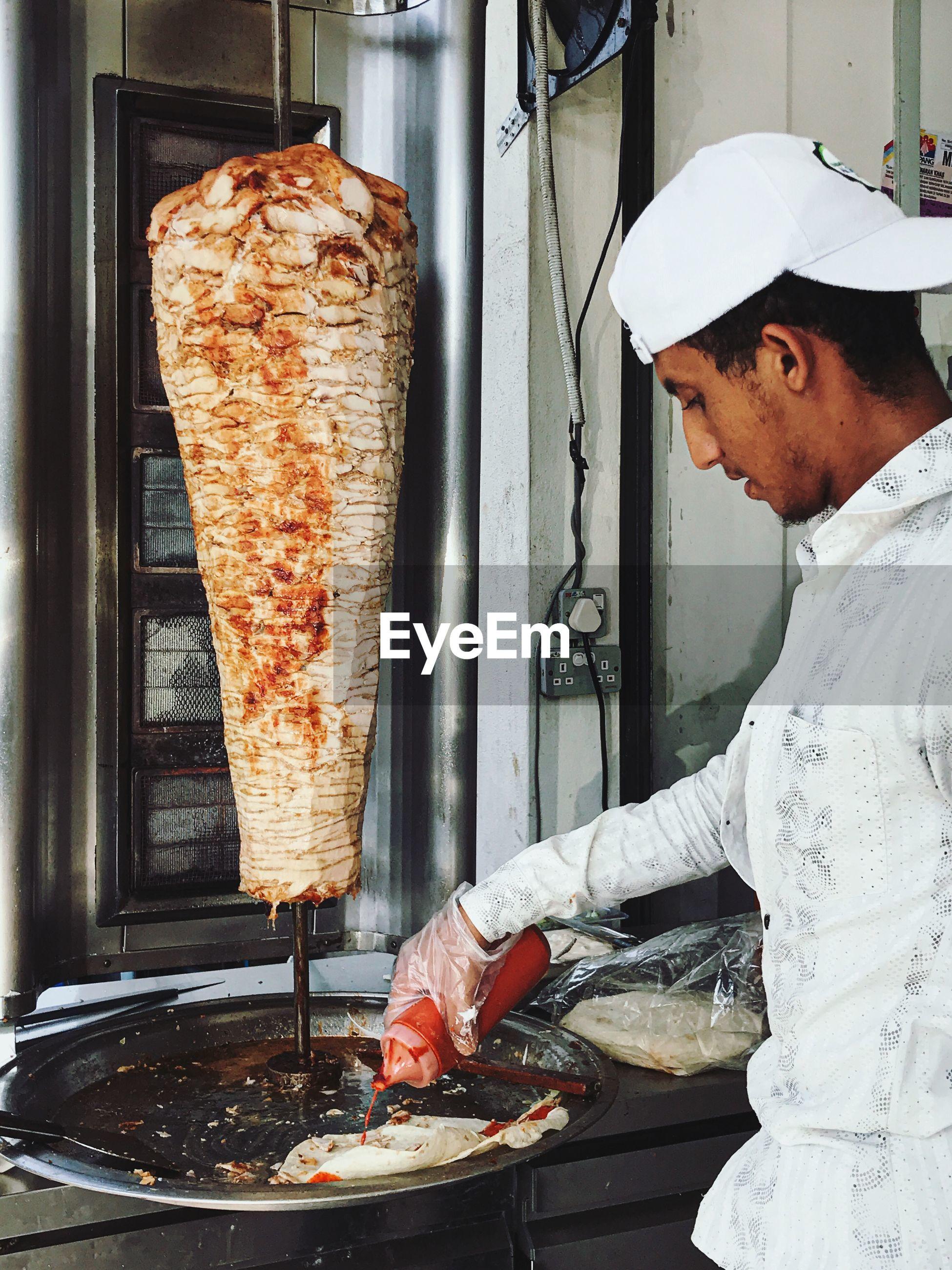 Man preparing shawarma in restaurant