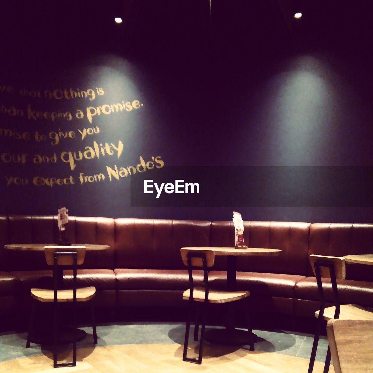 text, illuminated, indoors, chair, no people, night, blackboard