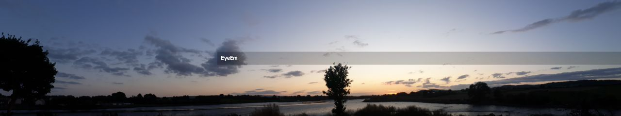 sky, sunset, beauty in nature, plant, cloud - sky, tree, tranquility, nature, tranquil scene, silhouette, scenics - nature, panoramic, no people, non-urban scene, landscape, growth, environment, outdoors, sun, dusk