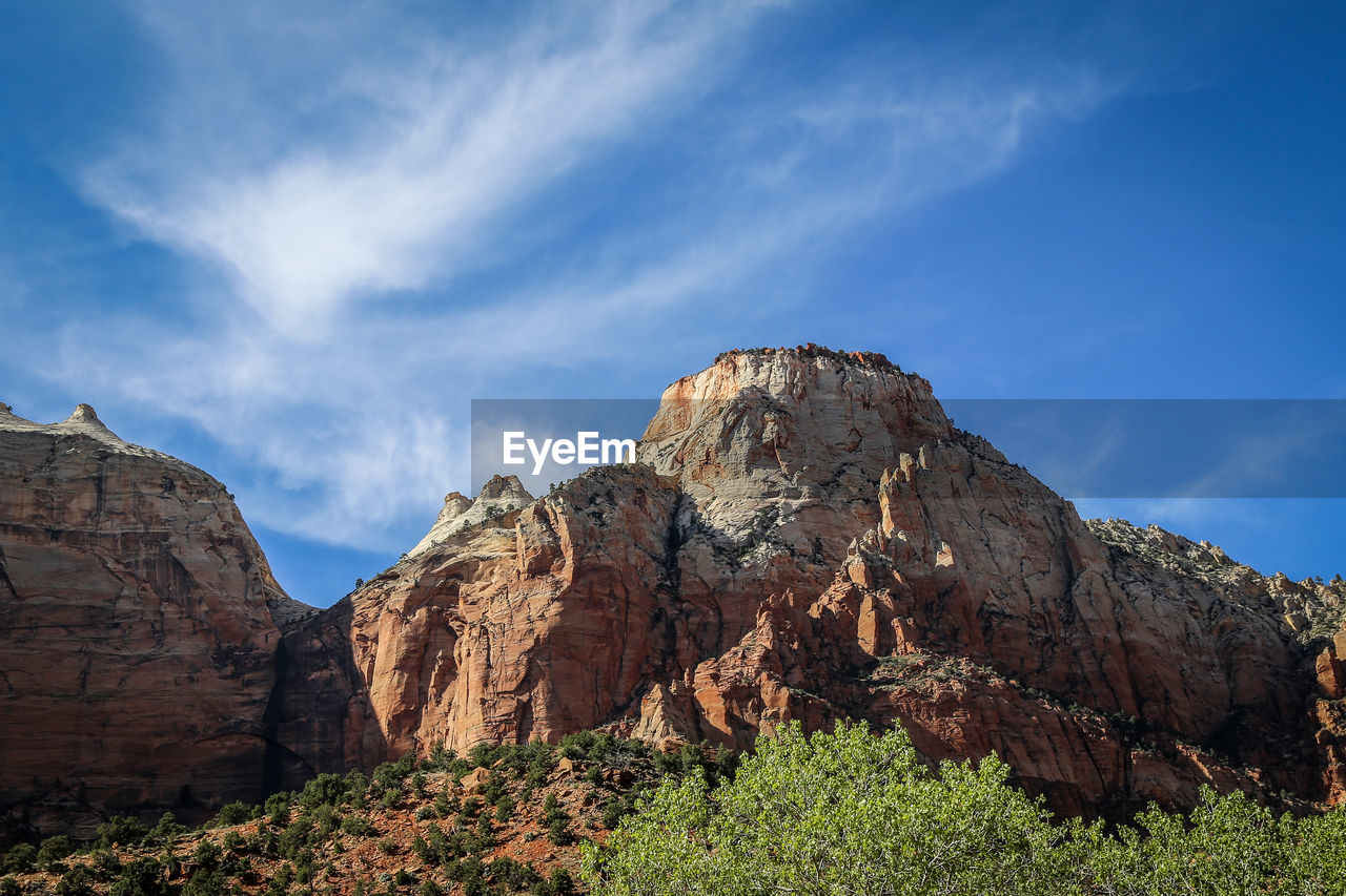 Rock Formations On Mountain Against Sky