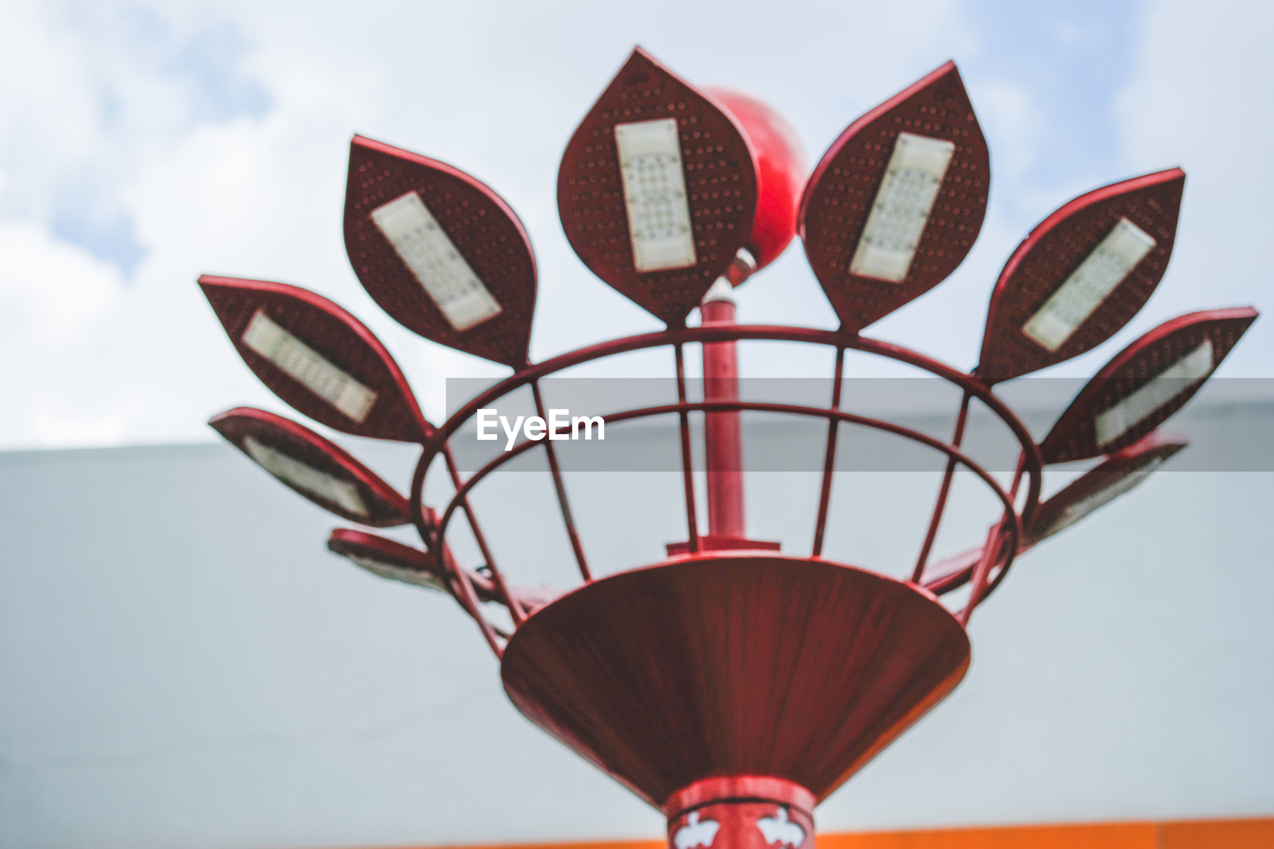 Low angle view of lamp lights against sky