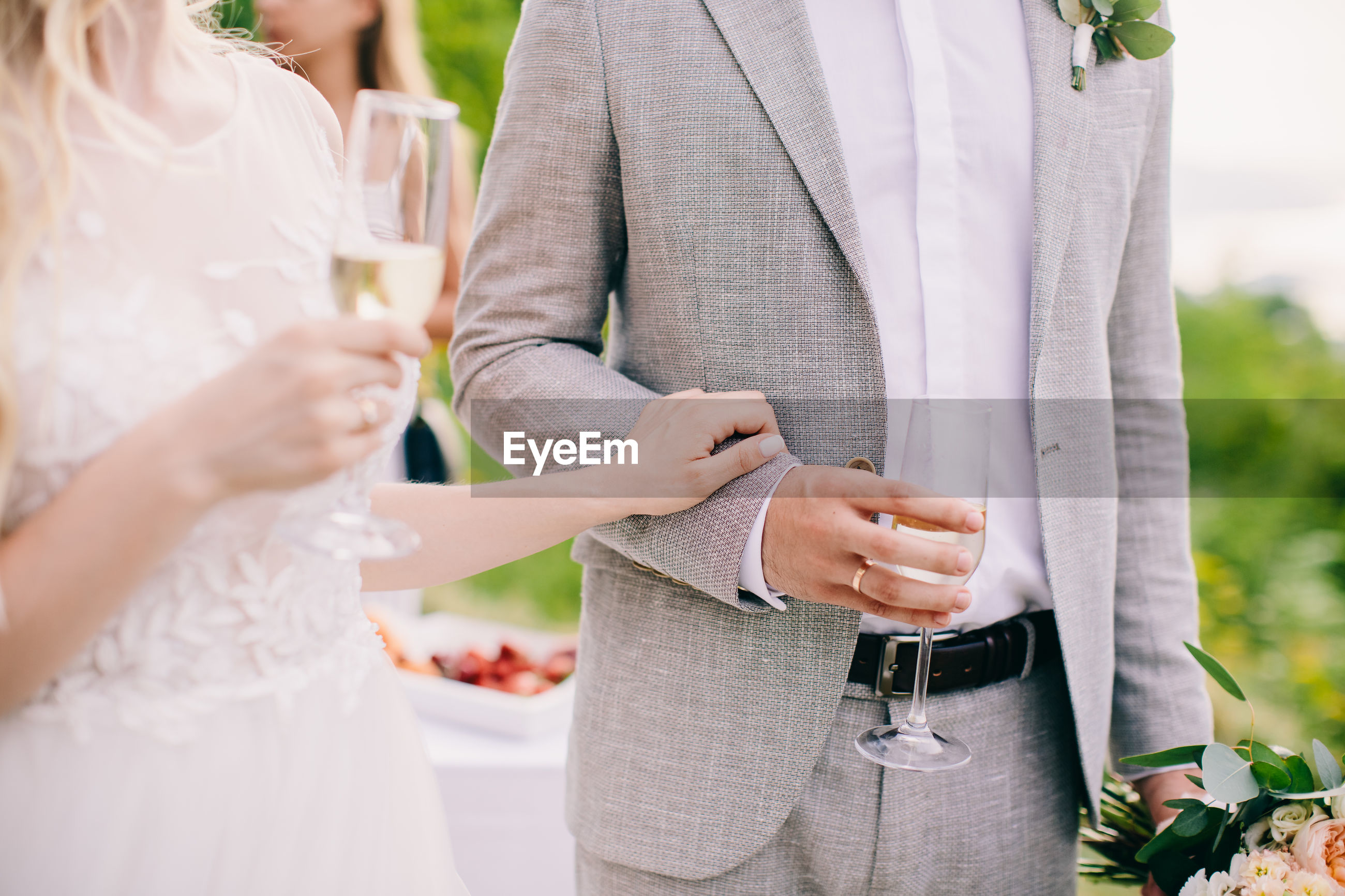 Midsection of couple having champagne