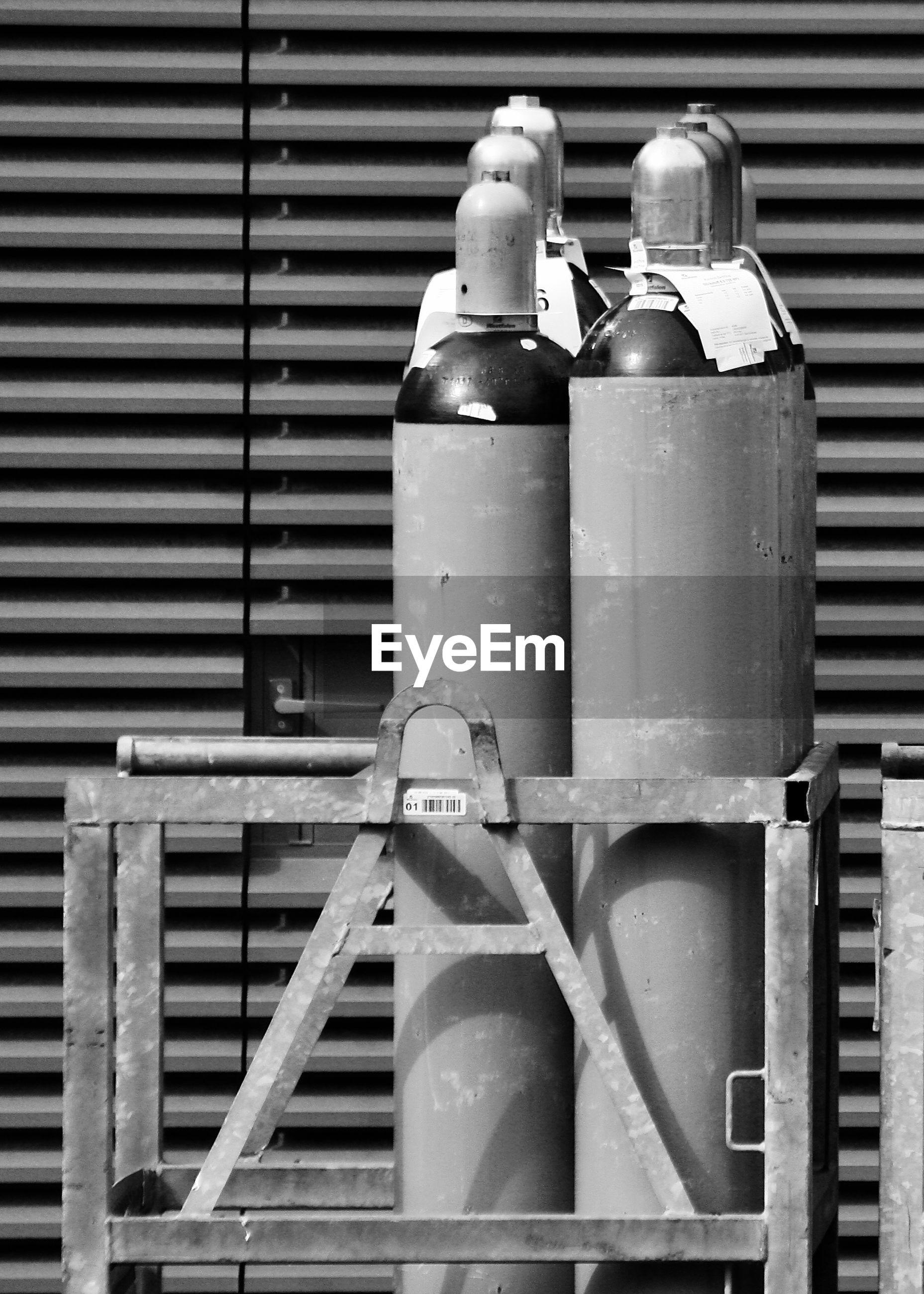 Close-up of oxygen tanks by door