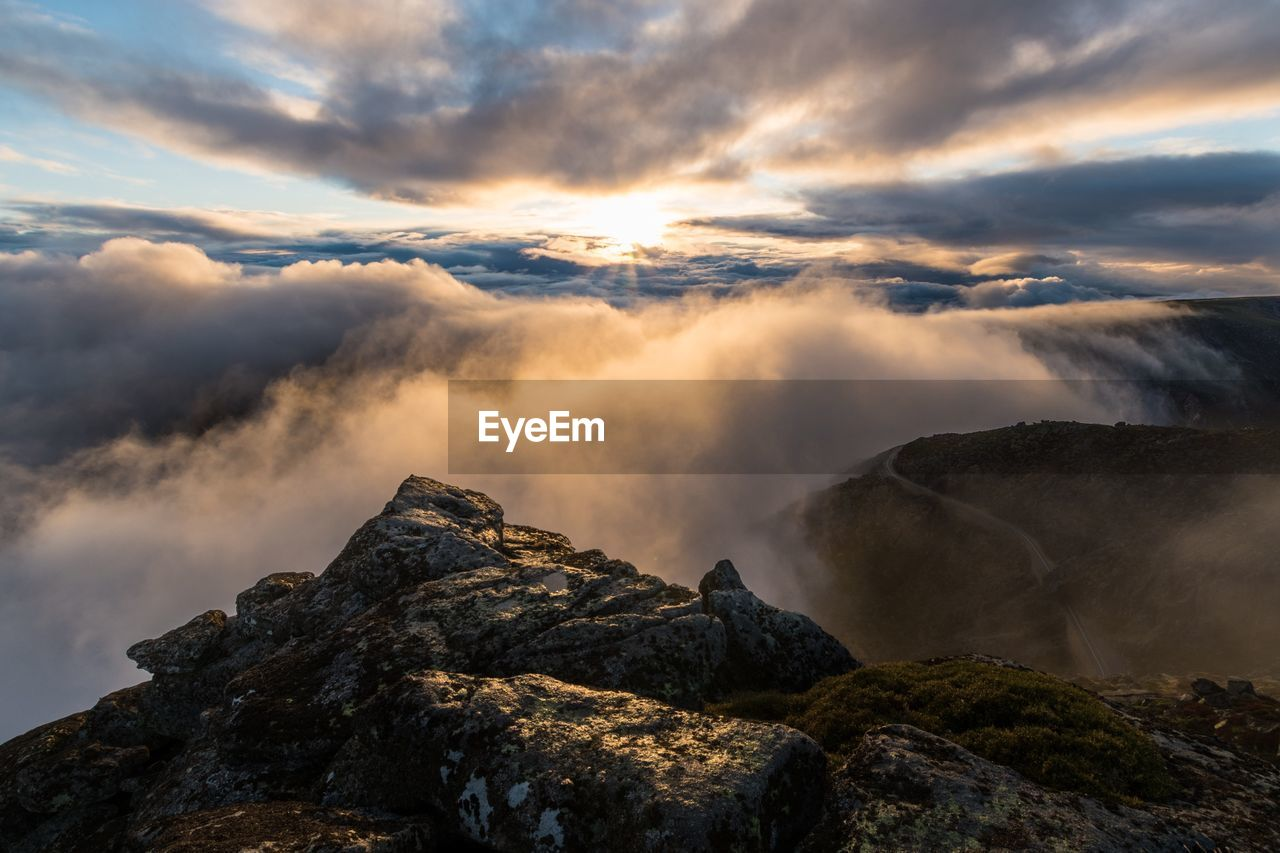 sky, cloud - sky, scenics - nature, beauty in nature, rock, solid, sunset, rock - object, tranquility, tranquil scene, mountain, nature, non-urban scene, no people, idyllic, environment, remote, rock formation, physical geography