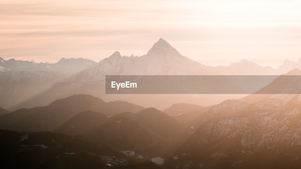 View of snowcapped mountains against sky during sunset