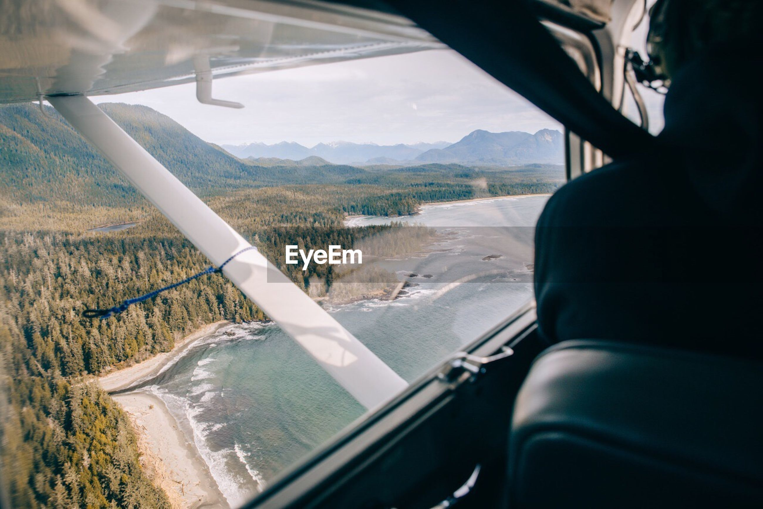 Scenic view of sea seen through airplane window