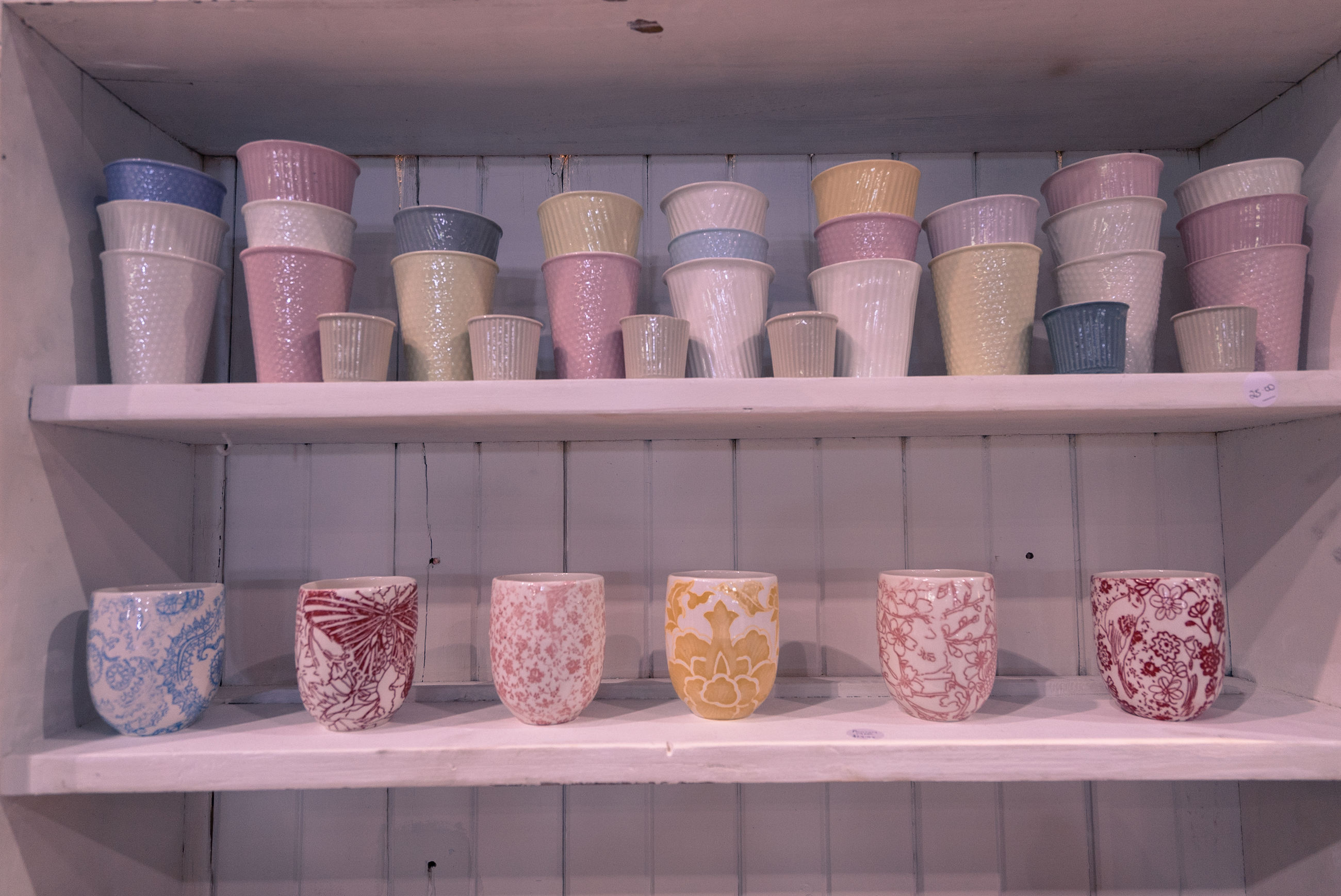 Ceramics vase and cups for sale at store