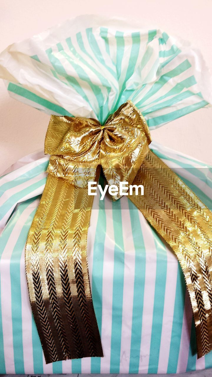 ribbon - sewing item, gold colored, indoors, no people, gift, wrapped, celebration, table, close-up, ribbon, day